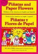 Piñatas and paper flowers by Lila Perl
